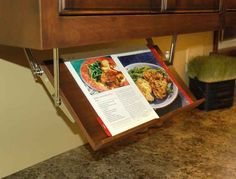 Pull down cookbook rack. And if cookbooks aren't your thing anymore, it works for your ipad as well!
