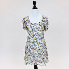 Floral Dress This floral dress has detailed sleeves with fun colors! Has white slip dress attached underneath. Pins & Needles Dresses