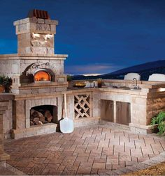Built-in brick oven in built-in backyard kitchen!!!!