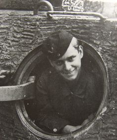 A happy crew member poses from the rear turret hatch of a Panther Ausf D from the SS Das Reich Division