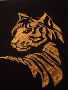 "A Tiger was made in "" Filografi Art "" which is called too "" String Art "" hope you like and pin it"