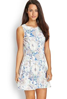 29ed527e5 Love 21 - A woven sleeveless dress featuring a floral print. . Concealed  back zipper
