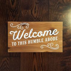 "This cedar sign is light and durable and makes a perfect addition to your entry way. You can even hang it outside because it's treated for outdoor use! It is hand-crafted and hand painted with meticulous care.     We pride ourselves on offering the lightest, most durable rustic materials, finished with ecologically friendly colouring and finishing agents. (Treated for Exterior Use)    16 x 9"" with hanging wire hardware installed for easy immediate hanging.    Wood is a product of nature…"