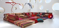 Modular sofa per elements, combining seat cushions, back and corner cushions that are padded and hand-sown. Possible to place seat cushions one on top of ...