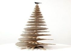 Celebrate a green Christmas by installing Cardboard Christmas Tree Spiral Christmas Tree, Recycled Christmas Tree, Cardboard Christmas Tree, Handmade Christmas Tree, Noel Christmas, Green Christmas, Xmas Tree, Christmas Ornaments, Spiral Tree