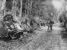 1914: A lone soldier with a bicycle stands amid the remains of a German motor convoy which lines a country lane after an attack by French field guns in the battle of the Aisne in France Topical Press Agency/Getty Images
