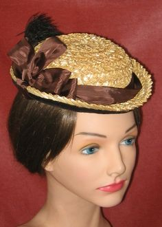 """Miranda"" is an early 1870's fancy straw hat with a shallow crown and narrow brim.  The underside is faced in dark brown cotton velvet.  The crown decoration is vintage rayon moiré ribbon with a vintage plume."