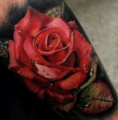 amazingly realistic, detailed rose tattoo