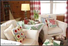 Creative Cain Cabin: Living Room with White Slipcovered Furniture. Love the colorful throw pillows and the green and white tablecloth. Toy cash register. Feedsack.