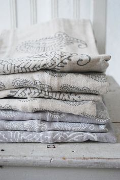 Paisley print doesn't have to be bright and hold here's some inspiration to make your own fabrics for fashion or soft furnishings using those winter whites and Grey's so en trend in Scandinavian styles decorated with complementary colour using a large wood block stamp