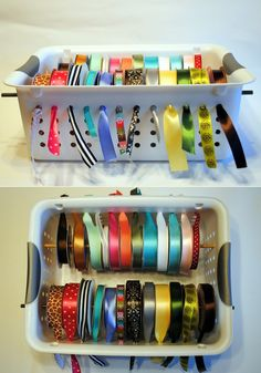 Spools of ribbon arranged in a plastic bin with holes in the side, loose ends sticking out through holes.