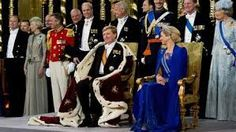 The cornation of King Willem-Alexander wearing the beautiful Royal cloak.