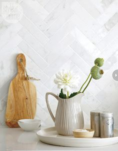 Maria: Will My White Kitchen be Cold? Pretty herringbone backsplash instead of subway tiles to add interest to the all white kitchen.Pretty herringbone backsplash instead of subway tiles to add interest to the all white kitchen. White Kitchen Backsplash, All White Kitchen, Kitchen Tiles, New Kitchen, Backsplash Ideas, Backsplash Tile, Tile Ideas, Kitchen Design, Kitchen Flooring