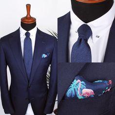 The Shifting blue blend tie, Flamingo silk pocket square and White herringbone collar-bar shirt. www.Grandfrank.com