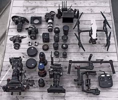 How many cameras do you see in this insane collection?  Photo by @16ozstudio #camera #gear #canon #dji #redweapon #canoneos #cameras #videoshooting #videography #moviemaking #equipment #lovemyjob