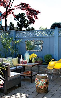 bring an inside living outside, by adding mirror, colorful all weather furniture and accesories