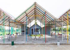 Vietnamese studio H&P Architects has used leftover construction materials to build a multicoloured community building in the grounds of a stadium in Vietnam's Ha Tinh province.