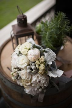 Wintry white and powdery blue bouquet with brunia berries and dusty miller foliage