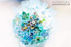 A gorgeous shot of an aqua colored origami wedding bouquet  - Aventura Photo Video - A Colorado Courtship Blog