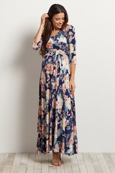 Once you put this maternity maxi dress on, you won't want to take it off! This versatile maxi is perfect to show off your bump during pregnancy, and will make nursing easy with a draped v-neckline. Style this dress with sandals for casual wear or wedges and a necklace for date night.