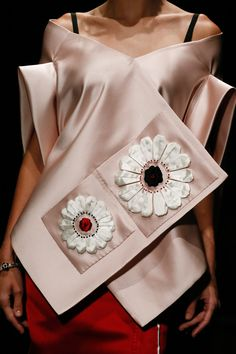 Prada Spring 2013 RTW.  This whole collection has an interesting combination of floral motifs and hard lines.