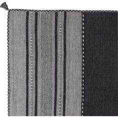 Tie together the den with this chic handwoven rug, or pair it with a weathered bench for a charming mudroom vignette.