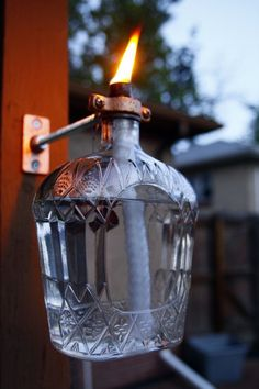 Decorative Bottles : Crown Royal Tiki Style Porch Torch with Holder & Mount -Read More – royal bottle crafts Decorative Bottles : Crown Royal Tiki Style Porch Torch with Holder & Mount - Decor Object Liquor Bottle Crafts, Liquor Bottles, Glass Bottles, Liquor Bottle Lights, Crown Royal Bottle, Crown Royal Bags, Crown Royal Quilt, Backyard Projects, Outdoor Projects