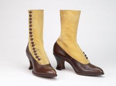 """Brown and tan button boots by Lady Luxury, American, 1914-1917. At the dawn of the twentieth century, women's dress became central to the discussion of women's suffrage. Some critics denigrated women's rights activists for their slovenly dress and unattractive footwear, while other anti-suffragists took the opposite tack, arguing that the suffragettes' acquiescence to fashion, such as the wearing of """"French heels"""" was a sure sign of their lack of reason. Many suffragettes attempted to strike…"""