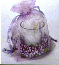Beautiful gift idea.  White votive candle in clear glass, with a colored ring of beading, and a color-coordinated organza bag.  Use the bag after for sachet, jewelry, etc.   Available in lavender, baby blue and burgundy.  $5.25