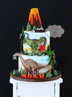 Dinosaur cake with 2D fondant t-rex, brontosaurus, volcano, and dinosaur eggs/nest.