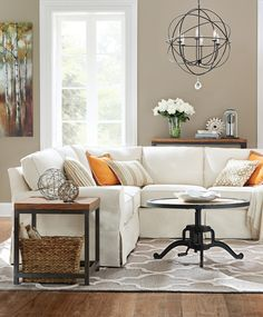 A super neutral space gets a fall update with a pop of orange pillows. (Now that's easy redecorating.) HomeDecorators.com
