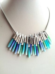 Beautiful polymer necklace. Could be redesigned with polymer and felted elements.   Ma-belette