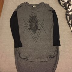 Long sleeve owl top The top is a dark gray and the sleeves are black. The back is longer than the front which is great with leggings! Never worn before. Tops Tees - Long Sleeve