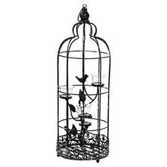 """Weathered metal candleholder with a birdcage design and scrolled base.   Product: CandleholderConstruction Material: Metal and glassColor: BlackAccommodates: (3) Candles - not includedDimensions: 26"""" H x 8.5"""" Diameter"""