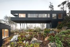 This Tofino residence is designed with environmental efficiencies: the flooring is recycled arbutus from blow-downs, the green roof is planted with moss, and it was built in a #prefab factory and trucked in.