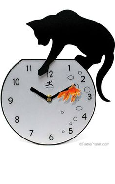 Contemporary Black Cat Wall Clock $48.99 Because I'm the crazy cat lady. I must have one.