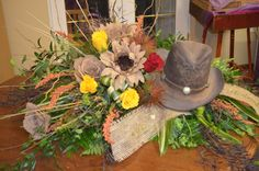Custom made casket spray for a true cowboy.  Made from a mixture of permanent and fresh botanicals and includes a very well worn, well used cowboy hat. Sarah's Flowers & Gifts 102 Legion Street Manchester IA 52057  www.sarahsflowersandgifts.com 563.927.8247  We offer free delivery to Bohnenkamp Murdoch Funeral Home and Leonard Muller Funeral Home in Manchester.