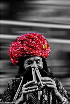 an Indian Rajasthani performer, via Flickr.