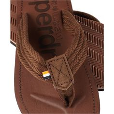 ed0fdbd5d2b6 Superdry men s Cove flip flops. A pair of classic flip flops that come with  a canvas upper and a foot bed that features toe grooves and a debossed  Superdry ...