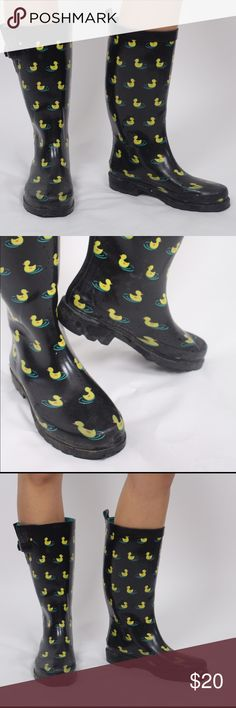 Rain boots Black rain boots with duck print, teal inner lining & thick tread on bottom for the toughest rainy weather. Come up to mid shin, below the knee, so you'll stay dry, even if it's raining men! Target Shoes Winter & Rain Boots