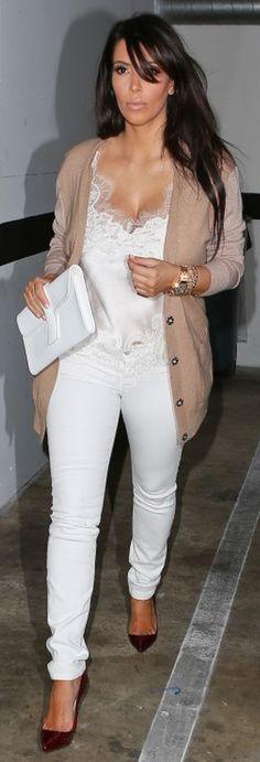 Kim Kardashian: Jeans – J Brand    Shirt – Carine Gilson    Sweater – Dries van Noten    Shoes – Christian Louboutin    Purse – Hermes