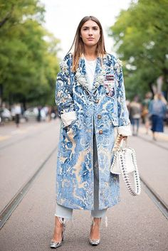 Patricia Manfield poses wearing a Miu Miu coat after the Fendi show during Milan Fashion Week Spring/Summer 2017 on September 22 2016 in Milan Italy