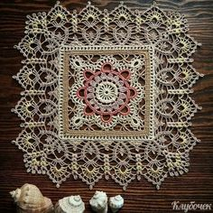 Image may contain: 1 person, indoor Crochet Tablecloth Pattern, Crochet Motif Patterns, Granny Square Crochet Pattern, Crochet Borders, Crochet Squares, Crochet Designs, Crochet Dollies, Crochet Art, Crochet Home