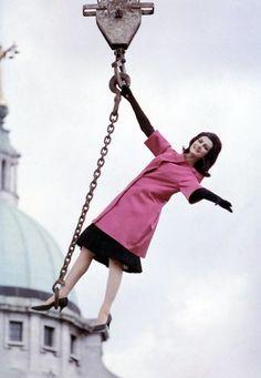 Carmen Dell'Orefice swings by in style, 1960. #vintage #fashion #1960s