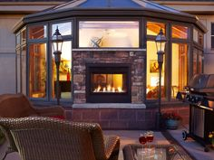 New Heat & Glo Indoor Outdoor fireplace with safe exterior glass.