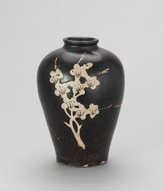 Jizhou ware bottle with resist decoration of flowering plum branch, Southern Song or Yuan dynasty, 13th century, Freer and Sackler Galleries