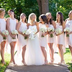 stunning bride, @kellyerbryant and her beautiful bridesbabes in the high neck hi-lo in powder pink // #stlwedding #stlouiswedding #bridesmaidsdresses #bridesmaids #bridesbabes #Padgram