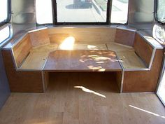 Front Seating Layout Idea Airstream Wrap Around Seating - Table converts to bed