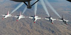 F-16 Fighting Falcons Thunderbirds perform a five-ship formation after refueling from a 92nd Air Refueling Wing KC-135 Stratotanker Sept. 1, 2014, over Glacier National Park, Mont. The Thunderbirds were making their way back to Nellis Air Force Base, Nev., where they are assigned to the 57th Wing's U.S. Air Force Air Demonstration Squadron. (U.S. Air Force photo/Airman 1st Class Janelle Patiño)