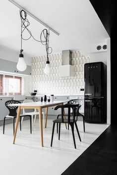 Kitchen. Dining Table. Black and White. Modern. Minimal. Black Refrigerator. Vintage. Decor. Design. Interior. Wallpaper.